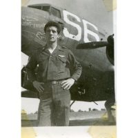 Captain Bill Watson in front of Night Fright undergoing a right engine change in mid-1944