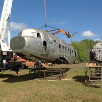 Fuselage being lowered on to its frame